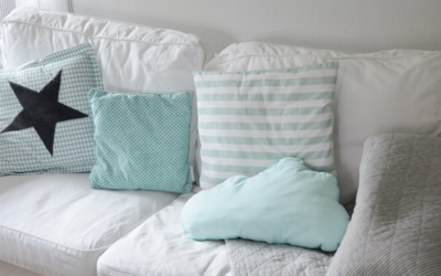 White sofa with blue pillows
